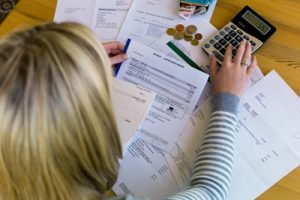 a woman with unpaid bills has many debts